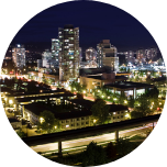 Nighttime city scene of Brampton, Canada, with lots of buildings and lights.